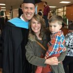 Dr. Erik Skogsberg with wife Amy and son Ezra at graduation ceremony.