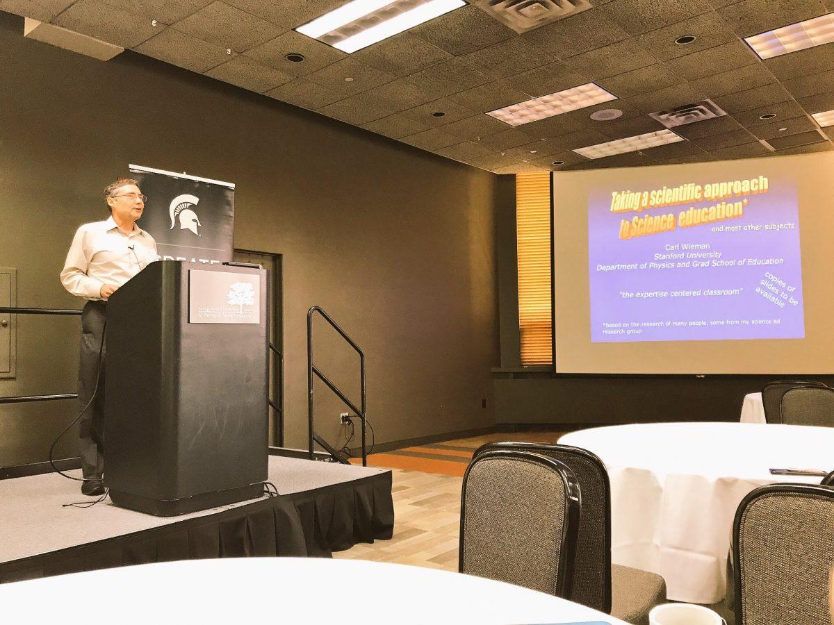 Dr. Wieman talks in front of crowd